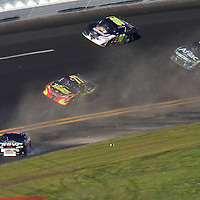 Regan Smith spins out of turn 4 during the Daytona 500 at Daytona International Speedway on February 20, 2011 in Daytona Beach, Florida. (AP Photo/Alex Menendez)