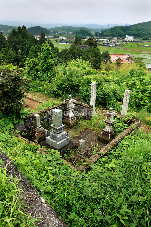family grave in rural setting Japan Hiroshima prefecture