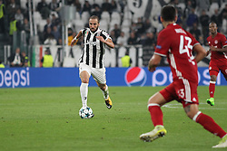 September 27, 2017 - Turin, Piedmont, Italy - Gonzalo Higuain (Juventus FC) in action during the UEFA Champions League (Group D) football match between Juventus FC and Olympiakos FC  at Allianz Stadium on 27 September, 2017 in Turin, Italy. .Juventus won 2-0 over Olympiakos. (Credit Image: © Massimiliano Ferraro/NurPhoto via ZUMA Press)