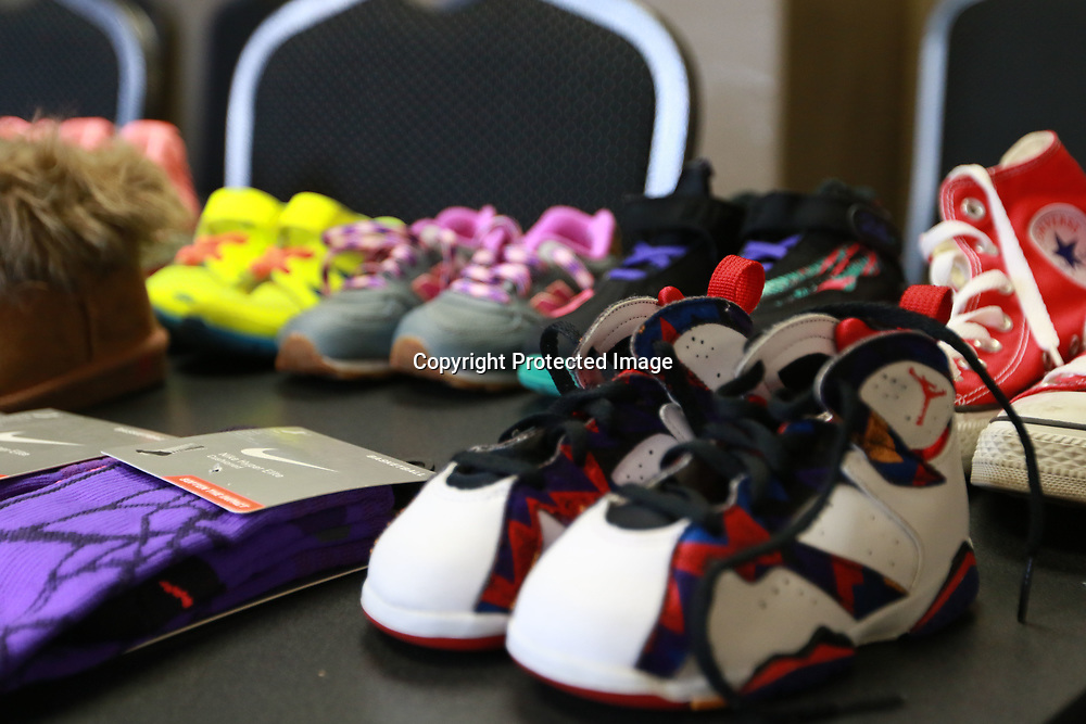 LIBBY EZELL   BUY AT PHOTOS.DJOURNAL.COM<br /> The community and police officers came together and donated over 100 shoes for the children who attended Saturday's Police and Kids fun day at the PAL building