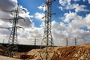 Electric power lines are running near the village of Wadi el Na'am, pop. 4000, close to Beer Sheva, the capital of the Negev, a large deserted area in the south of Israel.  Wadi el Na'am is located near a large industrial site, Ramat Hovav, and has no infrastructure or electric energy. Water is provided only via storage tanks. It has no health services as the only clinic is deemed illegal and bound to be demolished, as the rest of the structures in the area. Numbering around 200.000 in Israel, the Bedouins constitute the native ethnic group of these areas, they farm, grow wheat, olives and live in complete self sufficiency. Many of them were in these lands long before the Israeli State was created and their traditional lifestyle is now threatened by subtle Governmental policies. The seven Bedouin towns already built are all between the 10 more impoverished towns in Israel. .