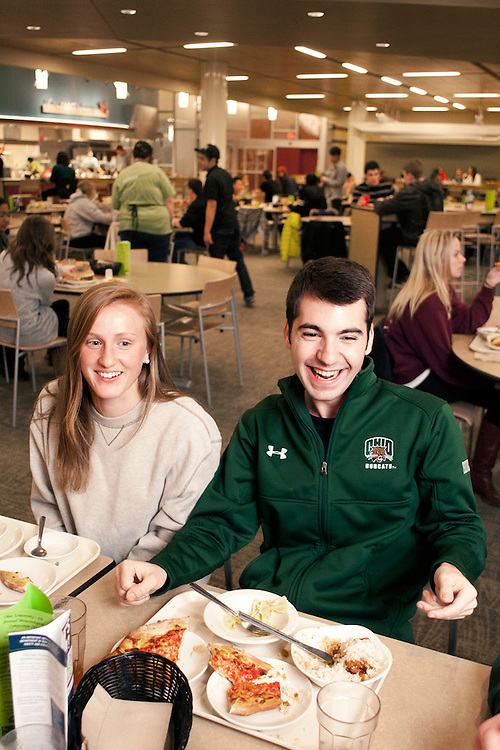 Bridget Mearns and Teddy Frantz laugh with friends at Nelson Dining Hall. Photo by: Ross Brinkerhoff. Dining Halls Nelson Facilities Buildings Students