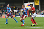 Gary McSheffrey  and Jacob Murphy during the Sky Bet League 1 match between Scunthorpe United and Coventry City at Glanford Park, Scunthorpe, England on 12 September 2015. Photo by Ian Lyall.