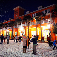 CELEBRATION, FL -- December 2, 2010 -- Children play in fake snow in the downtown area of in the small, Disney master-planned community just a block away from the crime scene of the town's first murder in Celebration, Fla., on December 2, 2010.  The town's first murder in its 14 year existence has drawn buzz worldwide and amongst its citizens alike.