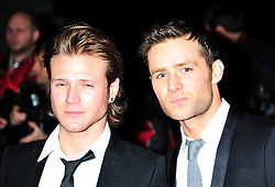© Licensed to London News Pictures. 19/12/2011. London, England. Dougie Poynter and Harry Judd attends a Night Of Heros , the Sun Military Awards 2011 held on Monday 19th Dec at the Imperial War Museum London . the awards will be televised on Wed 21st December 2011 .  Photo credit : ALAN ROXBOROUGH/LNP