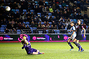 Manchester City forward Nikita Parris (17) chips Everton goalkeeper Kirstie Levell (1) to score Manchester City Women's Team third goal 3-1 during the FA Women's Super League match between Manchester City Women and Everton Women at the Sport City Academy Stadium, Manchester, United Kingdom on 20 February 2019.