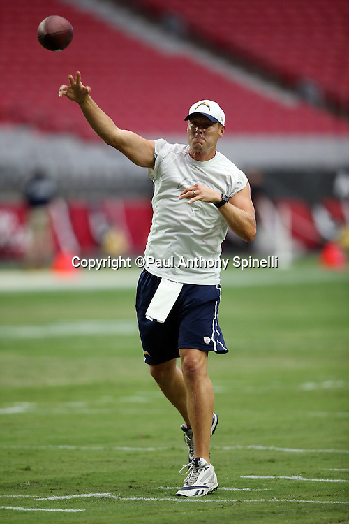 San Diego Chargers quarterback Philip Rivers (17) throws a pass while warming up in street clothes before the 2015 NFL preseason football game against the Arizona Cardinals on Saturday, Aug. 22, 2015 in Glendale, Ariz. The Chargers won the game 22-19. (©Paul Anthony Spinelli)