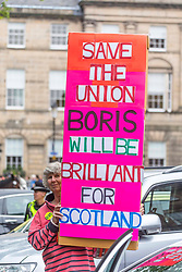 Prime Minister and Conservative Leader, Boris Johnson visits Bute House to meet First Minister of Scotland, Nicola Sturgeon. Earlier in the day, Johnson announced £300m of funding for projects to boost the economy in Scotland, Wales and Northern Ireland.<br /> <br /> Pictured: Pro-Union supporters before Boris Johnson arrives