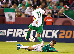 February 24, 2010; San Francisco, CA, USA;  Mexico midfielder Luis Miguel Noriega (13) tackles the ball from Bolivia midfielder Samuel Galindo (11) during the second half at Candlestick Park. Mexico defeated Bolivia 5-0.