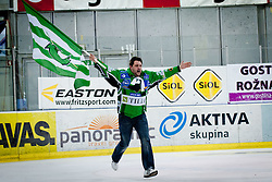 Fan celebrates after victory of HDD Tilia Olimpija during ice-hockey match between HDD Tilia Olimpija and SAPA Fehervar AV19 at sixth match in Quarterfinal  of EBEL league, on March 1, 2012 at Hala Tivoli, Ljubljana, Slovenia. HDD Tilia Olimpija won 4:3 and advanced to semifinal. (Photo By Matic Klansek Velej / Sportida)