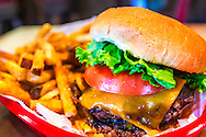 The Village Burger, at Village Burger restaurant in Dunwoody, Georgia, features two beef patties, cheese, lettuce, tomato, and village sauce. The family-owned restaurant opened in 2010. (Photo by Carmen K. Sisson/Cloudybright)