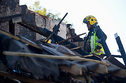© Licensed to London News Pictures. 22/10/2018. LONDON, UK.  A member of the Fire Investigations Team at work at the site of a fire in a first-floor flat, caused by a suspected gas explosion, in Fulbeck Way, Harrow, north west London, which took place in the early hours of 21 October.  It has been reported that a woman died at the scene, and another woman, a man and a baby were rescued from the property. Investigations continue as to the cause of the fire. Photo credit: Stephen Chung/LNP