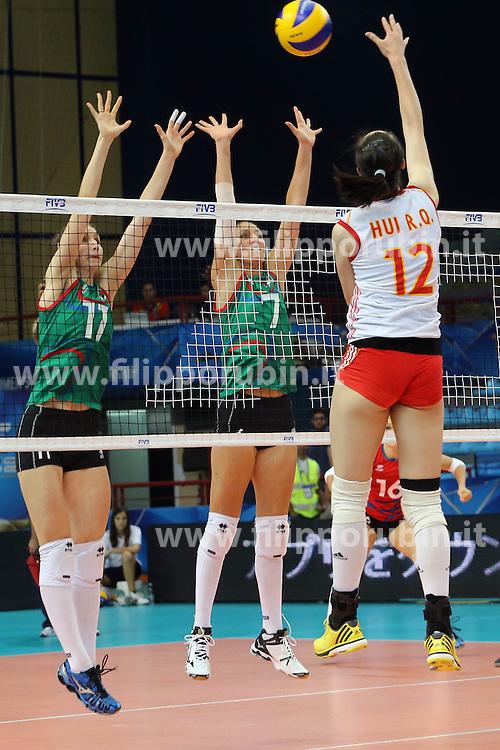Azerbaijan Polina Rahimova and Azerbaijan Yelena Parkhomenko try to block China Hui Ruoqi