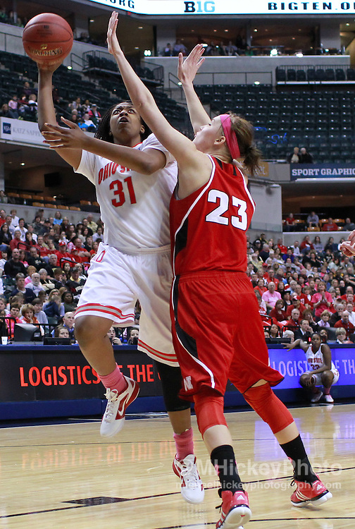 March 03, 2012; Indianapolis, IN, USA; Ohio State Buckeyes guard Raven Ferguson (31) shoots the ball against Nebraska Cornhuskers forward Emily Cady (23) during the semifinals of the 2012 Big Ten Tournament at Bankers Life Fieldhouse. Nebraska defeated Ohio State 77-62. Mandatory credit: Michael Hickey-US PRESSWIRE