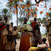 A group of Nuba people rests under the shade of a tree before continue the three to four day journey to a refugee camp in the neighbour South Sudan. Thousands have fled the bombardments and hunger in South Kordofan.