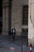 Single lady tourist takes pictures on camera phone near Piazza degli Uffizi.