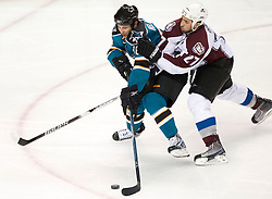 April 22, 2010; San Jose, CA, USA; San Jose Sharks center Dwight Helminen (left) controls the puck while being pressured by Colorado Avalanche defenseman Kyle Quincey (27) during the second period of game five in the first round of the 2010 Stanley Cup Playoffs at HP Pavilion.  San Jose defeated Colorado 5-0. Mandatory Credit: Jason O. Watson / US PRESSWIRE