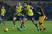 Oxford United defender Curtis Nelson (5) makes a tackle on Bradford City midfielder Mark Marshall (7) 0-0 during the EFL Trophy match between Oxford United and Bradford City at the Kassam Stadium, Oxford, England on 31 January 2017. Photo by Alan Franklin.