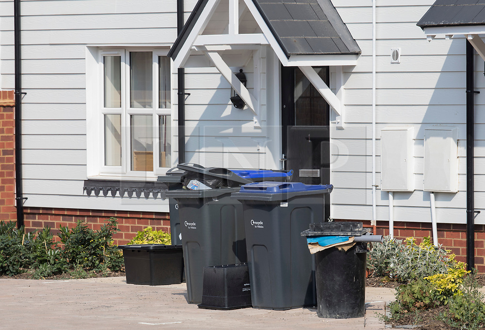 © Licensed to London News Pictures. 04/07/2018. Amesbury, UK. Un-emptied rubbish bins are seen behind a police cordon in Muggleton Road, Amesbury after a couple named locally as Dawn Sturgess, 44, and her partner Charlie Rowley, 45, were taken ill on Saturday 30th June 2018. Police have confirmed that the couple have been in contact with Novichok nerve agent. Former Russian spy Sergei Skripal and his daughter Yulia were poisoned with Novichok nerve agent in nearby Salisbury in March 2018.Photo credit: Peter Macdiarmid/LNP