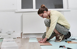 February 14, 2018 - Woman fitting new floor board (Credit Image: © Mint Images via ZUMA Wire)