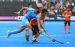 India's Ramandeep Singh (left) and Malaysia's Fitri Saari battle for the ball during the Men's World Hockey League match at Lee Valley Hockey Centre, London.