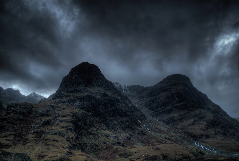 The Three Sisters of Glen Coe, Glen Coe, Highlands, Scotland. the Three sisters are three steep-sided ridges on the southern side of Glen Coe.  These ridges are Gearr Aonach (Short Ridge), Aonach Dubh (Black Ridge) and Beinn Fhada (Long Hill).
