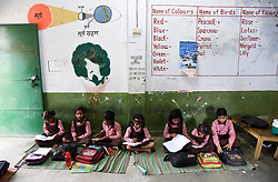 September 7, 2017 - Allahabad, Uttar Pradesh, India - Allahabad: Students attend a class at a government primary school on the eve of World Literacy day in Allahabad on 07-09-2017. September 8 was declared International Literacy Day by UNESCO on November 17, 1965. Its aim is to highlight the importance of literacy to individuals, communities and societies. Celebrations take place in several countries (Credit Image: © Prabhat Kumar Verma via ZUMA Wire)