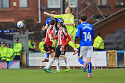 Simon Moore punches clear under pressure from Steven Davies during the EFL Sky Bet League 1 match between Rochdale and Sheffield Utd at Spotland, Rochdale, England on 4 March 2017. Photo by Daniel Youngs.