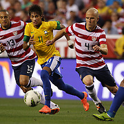 Neymar, Brazil, is challenged by Jermaine Jones, (left) and Michael Bradley, USA, during the USA V Brazil International friendly soccer match at FedEx Field, Washington DC, USA. 30th May 2012. Photo Tim Clayton