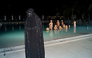 "OLYMPIA SCARRY IN CHADOR IN FRONT OF MODELS PERFORMING VANESSA BEECHCROFT INSTALLATION, Neville Wakefield and Playboy host ÒNude as MuseÓ evening art salon. Standard Hotel.  Miami. 4 December 2010. -DO NOT ARCHIVE-© Copyright Photograph by Dafydd Jones. 248 Clapham Rd. London SW9 0PZ. Tel 0207 820 0771. www.dafjones.com.<br /> OLYMPIA SCARRY IN CHADOR IN FRONT OF MODELS PERFORMING VANESSA BEECHCROFT INSTALLATION, Neville Wakefield and Playboy host ""Nude as Muse"" evening art salon. Standard Hotel.  Miami. 4 December 2010. -DO NOT ARCHIVE-© Copyright Photograph by Dafydd Jones. 248 Clapham Rd. London SW9 0PZ. Tel 0207 820 0771. www.dafjones.com."