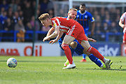 Ryan McLaughlin tackles Denver Hume during the EFL Sky Bet League 1 match between Rochdale and Sunderland at Spotland, Rochdale, England on 6 April 2019.