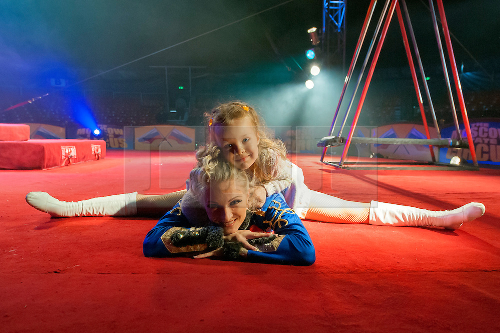 © Licensed to London News Pictures. 04/06/14 Fulham. UK. Olga Siamionava stretching out with her daughter before rehearsals for the Moscow State Circus which is performing at The Lillie Road Recreation Ground, Fulham, London on June 04 2014. Performances run until the 8th June.. Photo credit : Arnaud Stephenson/LNP