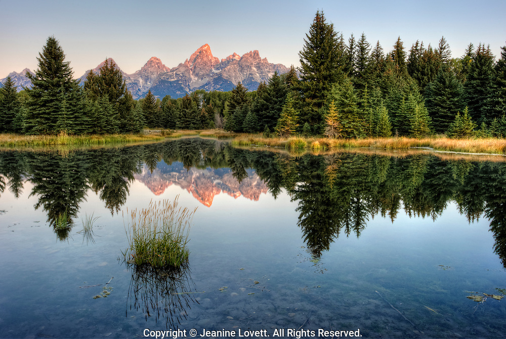 classic view of Grand Tetons, Wyoming reflected in the water