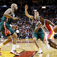 22 January 2012: Miami Heat point guard Mario Chalmers (15) drives past Milwaukee Bucks point guard Beno Udrih (19) during the Milwaukee Bucks 91-82 victory over the Miami Heat at the AmericanAirlines Arena, Miami, Florida, USA.