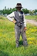 Full length portrait of elderly man standing in rural countryside area, Romania, eastern Europe 1967