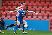 Andrija Novakovich and Rory McAuley during the FA Trophy match between Cheltenham Town and Chelmsford City at Whaddon Road, Cheltenham, England on 12 December 2015. Photo by Antony Thompson.