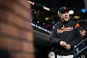 San Francisco Giants manager Bruce Bochy (15) watches his team host the Colorado Rockies from the dugout at AT&T Park in San Francisco, California, on April 14, 2017. (Stan Olszewski/Special to S.F. Examiner)