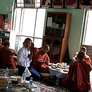 "May 14, 2013 - Mandalay, Myanmar: Ashin Wirathu (centre), the spiritual leader of Burma's Buddhist Nationalist anti-Muslim movement 969 group, takes a midday meal offered by regular citizens at Mosayein Monastery in central Mandalay. Wirathu, who was jailed in 2003 for inciting religious hatred, refers to himself as ""the Burmese Bin Laden"". (Paulo Nunes dos Santos/Polaris)"