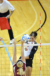 13 September 2011: Leighann Hranka strikes the ball towards the Loyola Ramblers defense during an NCAA volleyball match between the Ramblers of Loyola and the Illinois State Redbirds at Redbird Arena in Normal Illinois.