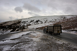 © Licensed to London News Pictures. 10/02/2020. Machynlleth, Powys, Wales, UK. A four-wheel-drive and trailer drive through a wintry landscape on a road in the Cambrian mountains between Machynlleth and Llanidloes in Powys.  Photo credit: Graham M. Lawrence/LNP