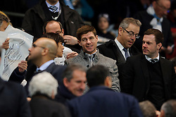 Steven Gerrard of Liverpool and England looks on from the stands bfore the match - Photo mandatory by-line: Rogan Thomson/JMP - Tel: 07966 386802 - 18/02/2014 - SPORT - FOOTBALL - Etihad Stadium, Manchester - Manchester City v Barcelona - UEFA Champions League, Round of 16, First leg.