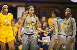 Jan 30, 2016; Morgantown, WV, USA; Baylor Bears forward Nina Davis (13) celebrates with guard Niya Johnson (2) after a foul was called during the first quarter against the West Virginia Mountaineers at WVU Coliseum. Mandatory Credit: Ben Queen-USA TODAY Sports