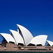 Sydney's Opera House on Bennelong Point with a clear blue sky on a sunny day