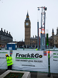 © Licensed to London News Pictures. 09/02/2016. London, UK. Members of Greenpeace have installed a 10 metre life-like fracking rig and drill in Parliament Square in London. The rig emits a flame created using bio ethanol. The protest coincides with the first day of the independent Planning Inspectorate inquiry into whether fracking will go ahead in Lancashire. Photo credit: Peter Macdiarmid/LNP