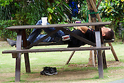 Singapore. Raffles Place. Man having a nap.