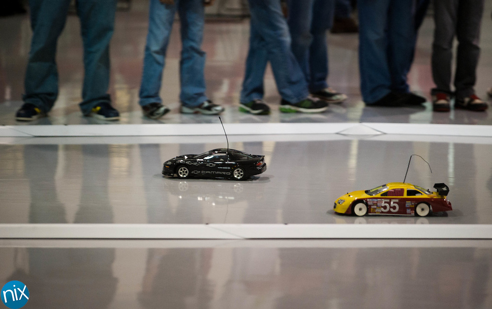 NASCAR Sprint Cup driver David Ragan races remote controlled cars with high school and middle school students from around the region at the NASCAR Research & Development Center in Concord Thursday morning. (Photo by James Nix)