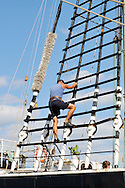 Man climbing shroud on tall ship Kruzenshtern