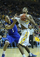 December 17, 2011: Iowa Hawkeyes guard/forward Roy Devyn Marble (4) eyes the basket as Drake Bulldogs forward Jordan Clarke (1) defends during the the NCAA basketball game between the Drake Bulldogs and the Iowa Hawkeyes at Carver-Hawkeye Arena in Iowa City, Iowa on Saturday, December 17, 2011. Iowa defeated Drake 82-68.
