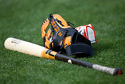 SAN FRANCISCO, CA - APRIL 11:  General view of a baseball bat and glove belonging to Pablo Sandoval #48 of the San Francisco Giants (not pictured) on the field before the game against the Colorado Rockies at AT&T Park on April 11, 2014 in San Francisco, California.  The San Francisco Giants defeated the Colorado Rockies 6-5. (Photo by Jason O. Watson/Getty Images) *** Local Caption ***