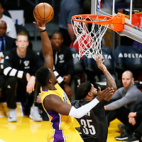 15 November 2016: Los Angeles Lakers forward Julius Randle (30) goes for the layup over Brooklyn Nets forward Trevor Booker (35) during the LA Lakers 125-118 victory over the Brooklyn Nets, at the Staples Center, Los Angeles, California, USA.